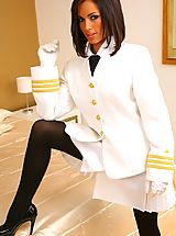 Only Tease Pics: Stunning brunette Gemma M in sexy Top Gun style uniform and thick black pantyhose.