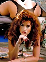 Suze Randall Pics: Get in to the Irish spirit this month with the lovely Julia - natural fiery red hair, speckled with freckles, skin like porcelain and a bod that will knock your kilt straight in the air.