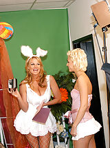 Kelly and Christine take turns hopping up and down on the Easter bunnies cock.