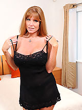 Darla Crane, Horny Darla Crane gets wild in bed as she stuffs her fingers in her hungry pussy