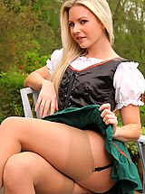 Jana D looks sexy, outside in her skimpy fraulein outfit.