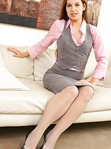 Office Sex, Michaela in cute pink and grey work outfit.