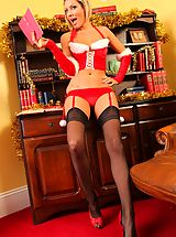 Stockings Pics: Naughty blonde poses in her sexy santa outfit.