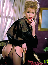 Beautiful blonde Brittany Shaw gets cumfy cozy on a silk bed in sexy black crotchless stockings.