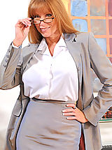 Classy secretary takes off her glasses and begins to strip