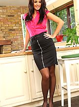 Busty secretary in a tight whit shirt and black pencil skirt with sheer black stockings.