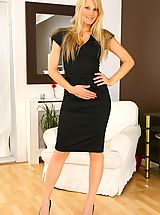 Only Secretaries, Sexy blonde wearing black dress and white stockings.