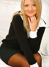 Blonde beauty Liana Lace relaxes on her sofa in nothing but holdup stockings. Non Nude